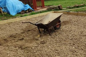 After the ground has been excavated then a layer of stone is laid down and compressed prior to concrete layer